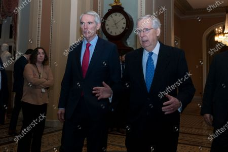 United States Senator Robert Portman (Republican of Ohio) and United States Senate Majority Leader Mitch McConnell (Republican of Kentucky) walk to the Senate Floor on Capitol Hill in Washington DC