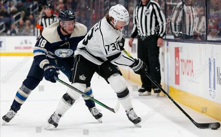 Columbus Blue Jackets' Pierre-Luc Dubois, left, chases Los Angeles Kings' Tyler Toffoli across the blue line during the third period of an NHL hockey game, in Columbus, Ohio