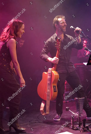 Kevin Johansen, Natalia Lafourcade. US-argentine singer Kevin Johansen sings with Mexico's Natalia Lafourcade during a concert in Mexico City's Lunario