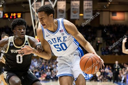 Duke's Justin Robinson (50) drives against Wofford's Zion Richardson (0) during an NCAA college basketball game in Durham, N.C