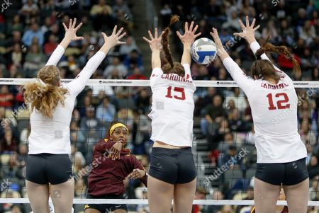 Stock Picture of Staford's Holly Campbell, left, Madeleine Gates (15) and Audriana Fitzmorris (12) go up to block a hit by Minnesota's Alexis Hart during the semifinals of the NCAA Division I women's volleyball championships, in Pittsburgh