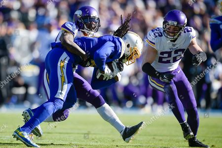 Mackensie Alexander, Mike Williams, Harrison Smith. Los Angeles Chargers wide receiver Mike Williams, front, runs after a catch while Minnesota Vikings cornerback Mackensie Alexander, left, and free safety Harrison Smith defend during the first half of an NFL football game in Carson, Calif