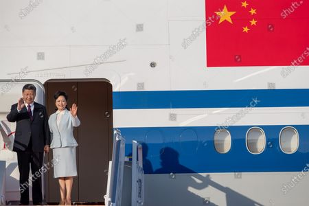 Chinese President Xi Jinping and his wife Peng Liyuan step out of the aircraft upon arrival at Macau International Airport