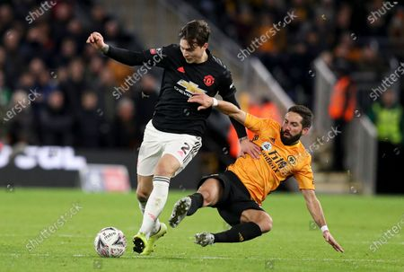 Victor Lindelof of Manchester United is tackled by Joao Moutinho of Wolverhampton Wanderers