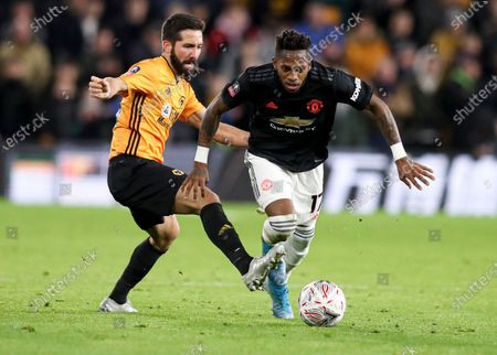 Fred of Manchester United and Joao Moutinho of Wolverhampton Wanderers