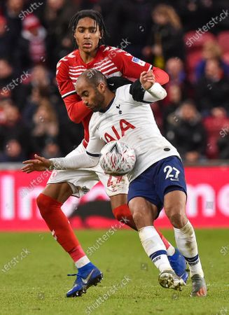 Djed Spence of Middlesbrough and Lucas Moura of Tottenham Hotspur