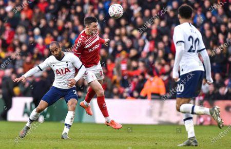 Jonny Howson of Middlesbrough beats Lucas Moura of Tottenham Hotspur to the ball