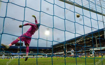 Goalkeeper Kristoffer Nordfeldt of Swansea City unable to stop Josh Scowen of Queens Park Rangers shot flying into the top corner