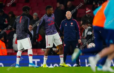 Stock Picture of Freddie Ljungberg warms up the Arsenal players