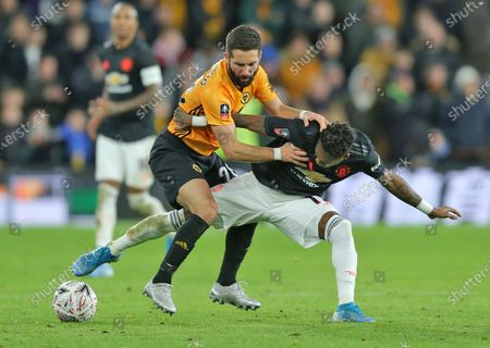 Fred of Manchester United and Joao Moutinho of Wolverhampton Wanderers tussle for the ball