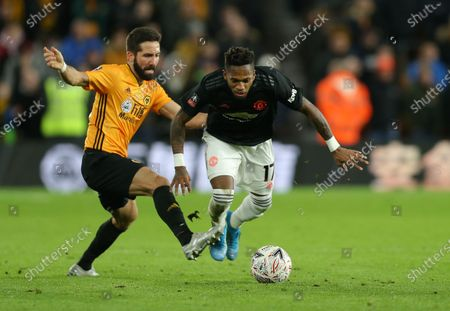 Fred of Manchester United tries to escape from the clutches of Joao Moutinho of Wolverhampton Wanderers