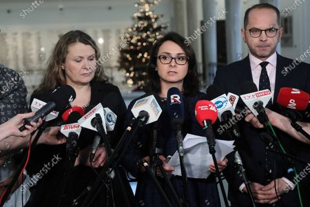 (L-R) Katarzyna Maria Piekarska, Kamila Gasiuk-Pihowicz and Michal Szczerba of the Civic Platform (PO) party talk with journalists before the parliamentary debate on the new judiciary bill in Sejm (lower house) in Warsaw, Poland, 20 December 2019. Last week, MPs from Law and Justice (PiS) submitted a comprehensive draft amendment to provisions relating to the courts and Supreme Court, as well as to administrative and military courts, and prosecutors. According to the authors of the legislation, the new solutions were intended to discipline judges who exceeded their powers. Opponents of the bill warned that the new legislation violates judicial independence.