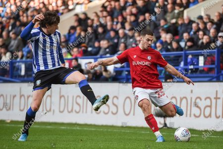 22nd December 2019, Hillsborough, Sheffield, England; Sky Bet Championship, Sheffield Wednesday v Bristol City : Tommy Rowe (25) of Bristol City whips a cross in despite the attention of Adam Reach (20) of Sheffield Wednesday Credit: Dean Williams/News Images