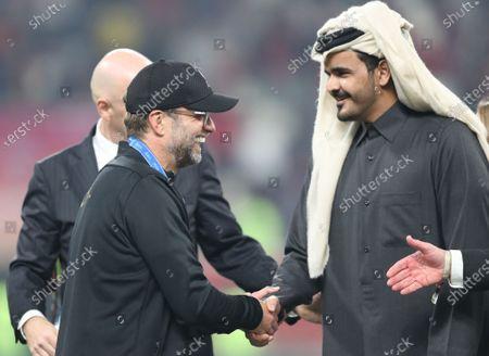 Juergen Klopp (L) head coach of Liverpool FC shakes hand with Sheikh Joaan bin Hamad bin Khalifa Al Thani (R) after the FIFA Club World Cup final soccer match between Liverpool FC and CR Flamengo in Doha, Qatar, 21 December 2019.