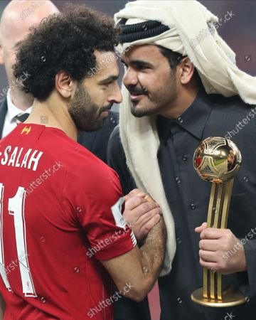Mohamed Salah (L) of Liverpool FC receives the trophy of best player from Sheikh Joaan bin Hamad bin Khalifa Al Thani (R) after the FIFA Club World Cup final soccer match between Liverpool FC and CR Flamengo in Doha, Qatar, 21 December 2019.
