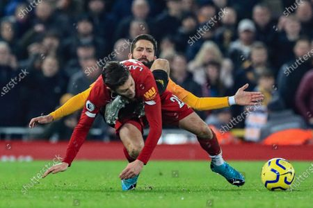 29th December 2019, Anfield, Liverpool, England; Premier League, Liverpool v Wolverhampton Wanderers : João Moutinho (28) of Wolverhampton Wanderers jockeys Adam Lallana (20) of Liverpool as they end up on a heap Credit: Mark Cosgrove/News Images