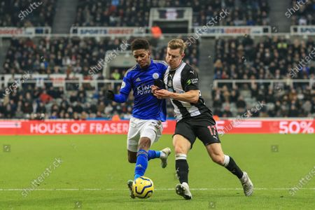 1st January 2020, St. James's Park, Newcastle, England; Premier League, Newcastle United v Leicester City : Emil Krafth (17) of Newcastle United shoulder barges Demarai Gray (7) of Leicester City off the ball as he pressures 
