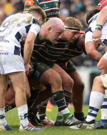 Leicester's Dan Cole (middle) and Tom Youngs (right) await Bristol put in at the scrum