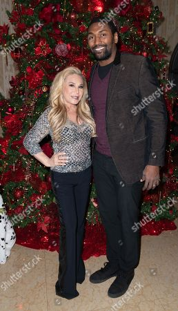 Stock Photo of (L-R) Adrienne Maloof-Nassif and Ron Artest attend Adrienne Maloof's Festival Of Trees in support of the Los Angeles Fire Department