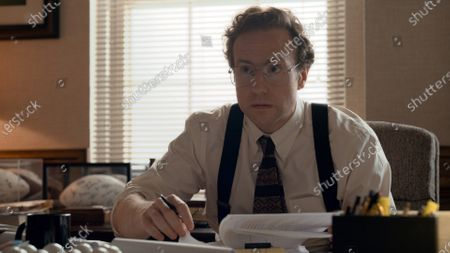 Rafe Spall as Tommy Champan