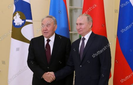 Russian President Vladimir Putin (R) shakes hands with former Kazakhstan's President Nursultan Nazarbayev (L), before a meeting of the Supreme Eurasian Economic Council in St. Petersburg, Russia, 20 December 2019.