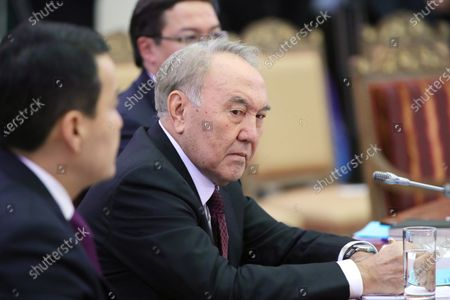 Kazakhstan's former President Nursultan Nazarbayev (R) attends a meeting of the Supreme Eurasian Economic Council in St. Petersburg, Russia, 20 December 2019.