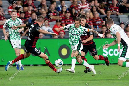 Western United midfielder Alessandro Diamanti (23) dribbles at Western Sydney Wanderers defender Matthew Jurman (6)