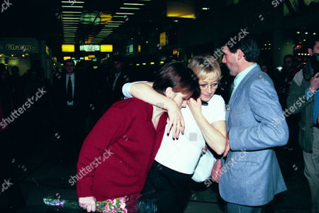 Sally Griffiths (red Jacket) And Claire Martin (beige Sweater) Arriving At Heathrow Airport - 1999
