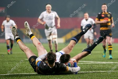 Young Munster vs Cork Constitution. Cork Constitution's JJ O'Neill scores a try despite Alan Tynan of Young Munster