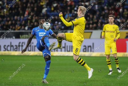 Hoffenheim's Diadie Samassekou (L) in action against Dortmund's Julian Brandt during the German Bundesliga soccer match between TSG 1899 Hoffenheim and Borussia Dortmund in Sinsheim, Germany, 20 December 2019.