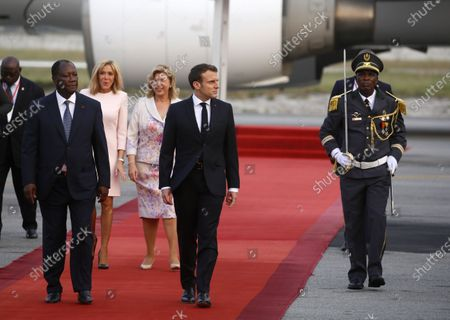 French President Emmanuel Macron (C), his wife Brigitte (2-), Ivory Coast's President Alassane Ouattara (L), and his wife Dominique Folloroux-Ouattara (3-L) inspect a guard of honour upon arrival in Abidjan, Ivory Coast, 20 December 2019. Macron began his official three-day visit to Ivory Coast before visiting Niger. The visit is expected to bolster economic ties with the former colony as well as focus on security issues within the region.