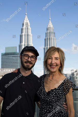 """From left, Director Nicolas Pesce and actress Lin Shay, are pictured in front of the Petronas Twin Towers while promoting their new film """"The Grudge"""", in Kuala Lumpur, Malaysia"""