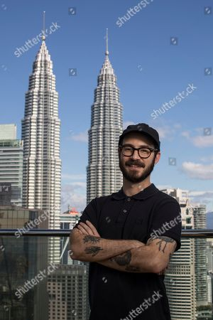 """Nicolas Pesce pictured in front of the Petronas Twin Towers while promoting his new film """"The Grudge"""", in Kuala Lumpur, Malaysia"""