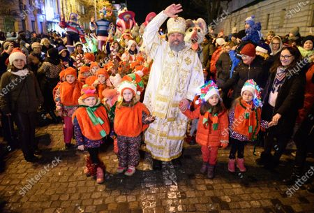 St. Nicholas marches with the children during the celebration.