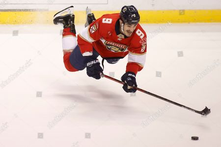 Florida Panthers' Brian Boyle reaches for the puck during the first period of the team's NHL hockey game against the Dallas Stars, in Sunrise, Fla