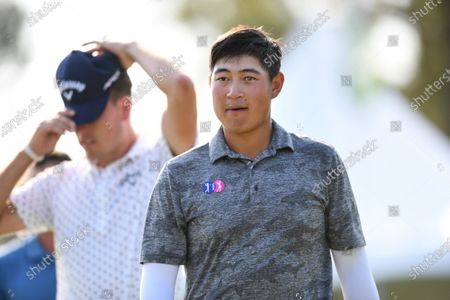 Golfers Yuan Yechun of China (R) and Anthony Quayle of Australia at the conclusion of day three of the 2019 Australian PGA Championship at the RACV Royal Pines Resort on the Gold Coast, Queensland, Australia, 21 December 2019.