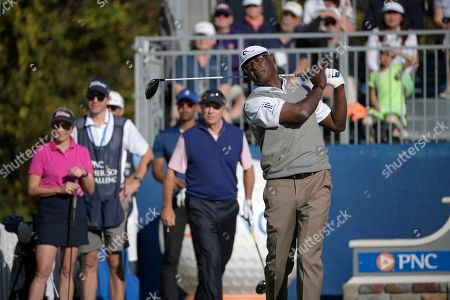 Vijay Singh, right, of Fiji Islands, tees off on the first hole as Jenni Pate, left, Qass Singh, center, and Jerry Pate, second from right, watch during the first round of the Father Son Challenge golf tournament, in Orlando, Fla