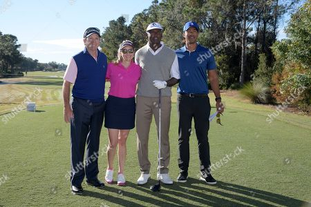 Jerry Pate, left, and his daughter Jenni Pate pose with Vijay Singh and his son Qass Singh, right, before their start on the first tee during the first round of the Father Son Challenge golf tournament, in Orlando, Fla