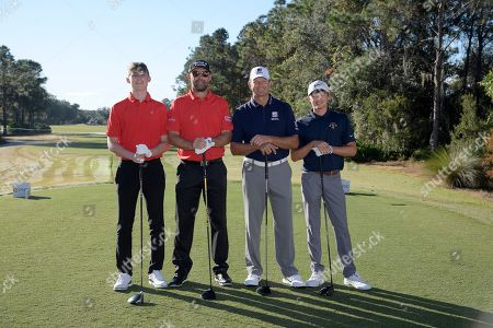 Padraig Harrington, second from left, and his son Paddy Harrington, left, pose with Retief Goosen and his son Leo Goosen, right, before their start on the first tee during the first round of the Father Son Challenge golf tournament, in Orlando, Fla