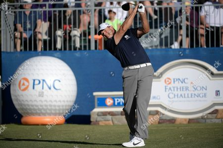Retief Goosen, of South Africa, tees off on the first hole during the first round of the Father Son Challenge golf tournament, in Orlando, Fla