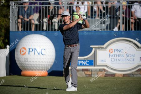Leo Goosen, son of Retief Goosen, of South Africa, tees off on the first hole during the first round of the Father Son Challenge golf tournament, in Orlando, Fla