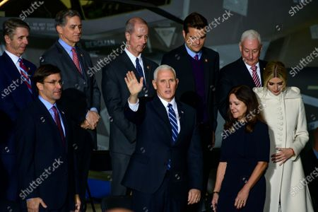 United States Vice President Mike Pence, center, waves to the crowd as he arrives prior to US President Donald Trump making remarks and signing S.1790, the National Defense Authorization Act for Fiscal Year 2020 at Joint Base Andrews in Suitland, Maryland. Pictured in the front row, from left to right: US Secretary of Defense Dr. Mark Esper, US Vice President Pence, Karen Pence, and First Daughter and Advisor to the President Ivanka Trump.