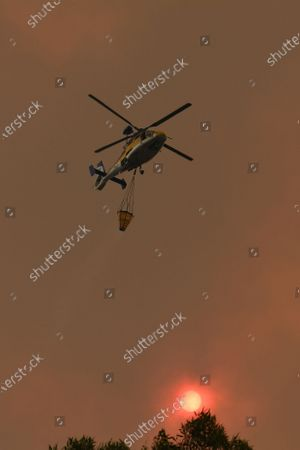 Stock Picture of Water bombing aircraft battle the Green Wattle Creek Fire as it threatens homes in Yandeera in the south west of Sydney, Australia, 21 December 2019. According to media reports, conditions are expected to worsen across much of the state as temperatures exceed 40 degrees Celsius.