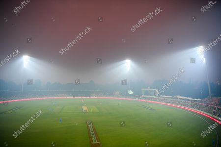 Stock Photo of Smoke haze from bushfires is seen covering the field of play during the Big Bash League (BBL) cricket match between the Sydney Thunder and the Adelaide Strikers at Manuka Oval in Canberra, Australia, 21 December 2019. According to media reports, conditions are expected to worsen across much of the state New South Wales (NSW) as temperatures exceed 40 degrees Celsius.