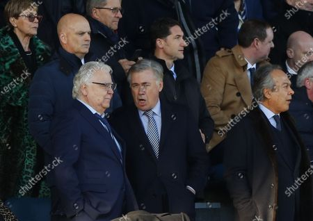 New Everton manager Carlo Ancelotti (C) speaks to Everton's chairman Bill Kenwright (L) and owner Farhad Moshiri (R) in the stands during the English Premier League soccer match between Everton FC and Arsenal FC at Goodison Park in Liverpool, Britain, 21 December 2019.