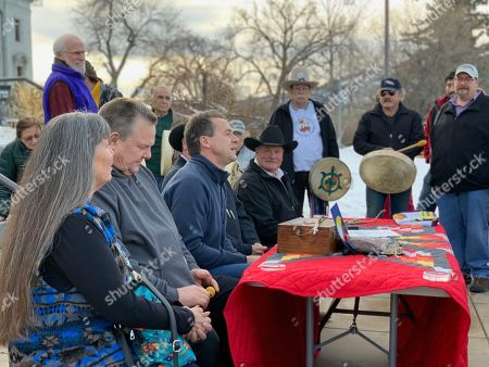 Montana Gov. Steve Bullock, third from left, speaks at an event marking the federal government's formal recognition of the Little Shell Tribe of Chippewa Indians, at the state capitol in Helena, Mont. Congress passed a measure recognizing the tribe after a decades-long struggle by its leaders