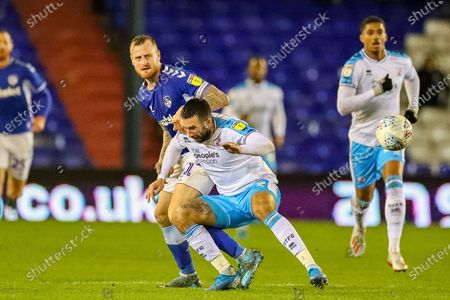 Crawley Town forward Ollie Palmer (9) tussles with Oldham Athletic defender David Wheater (31) during the EFL Sky Bet League 2 match between Oldham Athletic and Crawley Town at Boundary Park, Oldham