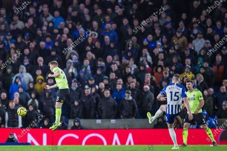 Stock Picture of George Baldock (Sheffield United) jumps into the air away from the ball coming from Adam Webster (Brighton) during the Premier League match between Brighton and Hove Albion and Sheffield United at the American Express Community Stadium, Brighton and Hove