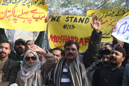 Supporters of former Pakistani military ruler Gen. Pervez Musharraf protest a court's decision, in Lahore, Pakistan, . The Pakistani court sentenced Musharraf to death in a treason case related to the state of emergency he imposed in 2007 while in power, officials said. Musharraf who is apparently sick and receiving treatment in Dubai where he lives was not present in the courtroom