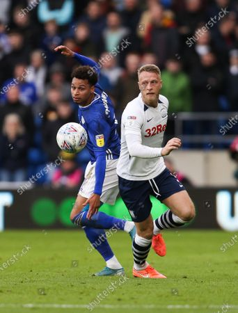 Josh Murphy of Cardiff City and Tom Clarke of Preston North End compete for the ball